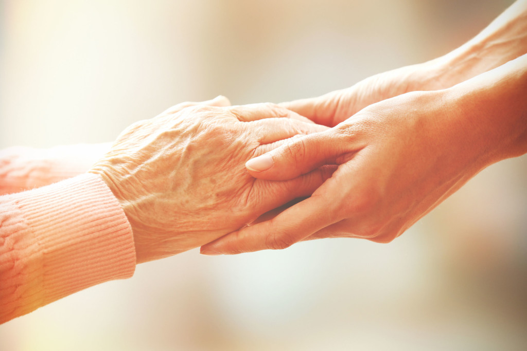 34932417 - helping hands, care for the elderly concept